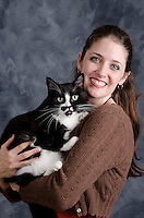 Dr. Juliana Lyles, DVM, (Class of 2009) with cat. (Pegasus press Fall 2013)