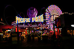 A night view of the Pacific Park entrance at Santa Monica Pier California.