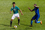 He Bai of Long Lions (L) fights for the ball with Kitchee Forward Alessandro Ferreira (R) during the Community Cup match between Kitchee and Eastern Long Lions at Mong Kok Stadium on September 23, 2017 in Hong Kong, China. Photo by Marcio Rodrigo Machado / Power Sport Images