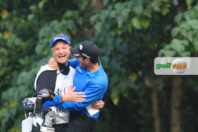 Gareth Maybin (NIR)with his caddy Basile Dalberto after he had a hole in one on the 4th on Day 2 of the UBS Hong Kong Open 2011...Photo GOLFFILE/Jenny Matthews.(Photo credit should read Jenny Matthews/GOLFFILE)