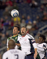 New England Revolution defender Ryan Cochrane (45) battles for head ball. In a Major League Soccer (MLS) match, the New England Revolution tied the Portland Timbers, 1-1, at Gillette Stadium on April 2, 2011.