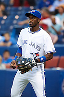 Toronto Blue Jays shortstop Adeiny Hechavarria #3 warms up before an American League game against the Seattle Mariners at the Rogers Centre on September 13, 2012 in Toronto, Ontario.  Toronto defeated Seattle 8-3.  (Mike Janes/Four Seam Images)