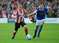 Lincoln City's Terry Hawkridge vies for possession with Macclesfield Town's Luke Summerfield<br /> <br /> Photographer Andrew Vaughan/CameraSport<br /> <br /> Vanarama National League - Lincoln City v Macclesfield Town - Saturday 22nd April 2017 - Sincil Bank - Lincoln<br /> <br /> World Copyright &copy; 2017 CameraSport. All rights reserved. 43 Linden Ave. Countesthorpe. Leicester. England. LE8 5PG - Tel: +44 (0) 116 277 4147 - admin@camerasport.com - www.camerasport.com
