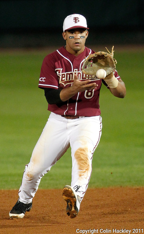 TALLAHASSEE, FL 10-FSU-B.C. BASE031111 CH-Florida State's Devon Travis fields a Boston College hit Friday at Dick Howser Stadium in Tallahassee. The Seminoles beat the Eagles 3-1..COLIN HACKLEY PHOTO