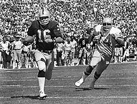 Raider quarterback Jim Plunkett runs for TD against the Seattle Seahawks #74 Manu Tuiasospo, (1981 photo/Ron Riesterer)