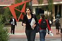 Mira Costa College student Varly Ismail heads for class on the Oceanside, California, campus in January, 2009.  photo for the North County Times