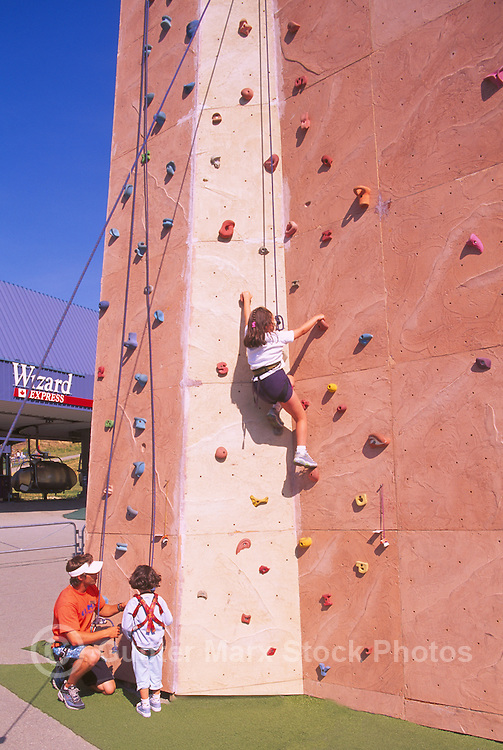 Climbing Wall, Whistler, BC, British Columbia, Canada - Children using Hand Holds to climb and reach for Top, Summer