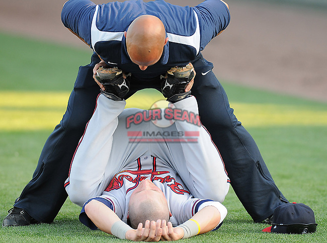 Strength and conditioning coordinator Steve Timmers works with infielder Chris Lovett (20) of the Rome Braves, Class A affiliate of the Atlanta Braves, just before a game against the Greenville Drive April 13, 2010, at Fluor Field at the West End in Greenville, S.C. Photo by: Tom Priddy/Four Seam Images
