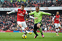 Carl Jenkinson of Arsenal vies for ball with a player of Aston Villa during the English Premier League soccer match between Arsenal and Aston Villa at the Emirates Stadium, London, Britain, on 23 February 2013.THOMAS CAMPEAN/Pixel8000 Ltd...