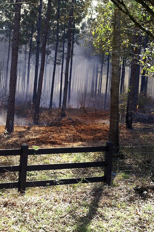 The plowed ground is a fire break used to control the fire during a burn.
