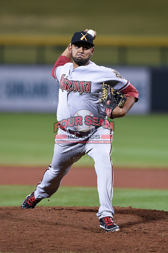 Salt River Rafters pitcher Enrique Burgos (48) during an Arizona Fall League game against the Mesa Solar Sox on October 18, 2014 at Cubs Park in Mesa, Arizona.  Mesa defeated Salt River 8-4.  (Mike Janes/Four Seam Images)