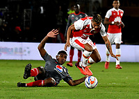 BOGOTA - COLOMBIA - 28 - 01 - 2018: Juan David Roa (Der.) jugador de Independiente Santa Fe disputa el balón con Elkin Blanco (Izq.) jugador de America de Cali, durante partido entre Independiente Santa Fe y America de Cali, por el Torneo Fox Sports 2018, jugado en el estadio Nemesio Camacho El Campin de la ciudad de Bogota. / Juan David Roa (R) player of Independiente Santa Fe vies for the ball with Elkin Blanco (L) player of America de Cali, during a match between Independiente Santa Fe y America de Cali, for the Fox Sports Tournament 2018, played at the Nemesio Camacho El Campin stadium in the city of Bogota. Photo: VizzorImage / Luis Ramirez / Staff.