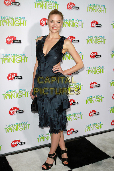 "JAIME KING.""Take Me Home Tonight"" Los Angeles Premiere held at Regal Cinemas LA Live, Los Angeles, California, USA..March 2nd, 2011.full length sleeveless dress hand on hip blue layered layers tiered low cut neckline.CAP/ADM/KB.©Kevan Brooks/AdMedia/Capital Pictures."