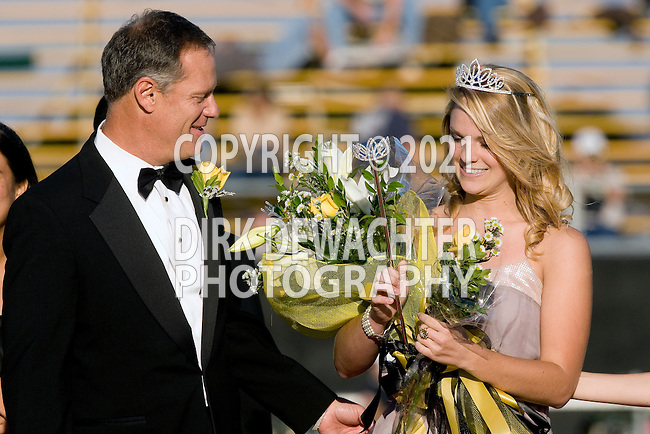 Palos Verdes, CA 11/06/09 - The 2009 Palos Verdes Peninsula High School Home Coming Queen is escorted by her father to the front of the grandstand.