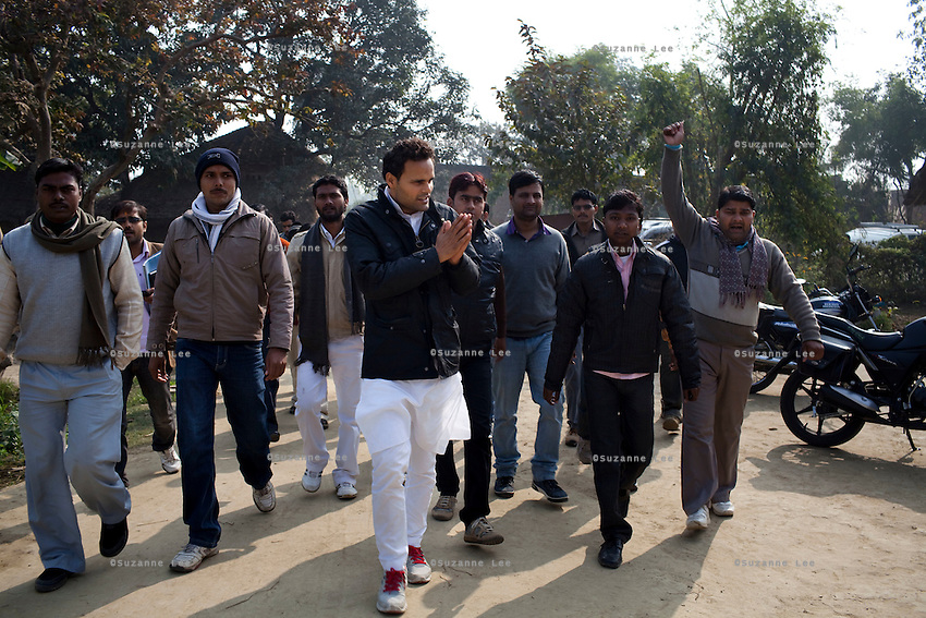 "Minister of Legislative Assembly, Ritesh Pandey, 30, is greeted by a crowd of supporters on motorbikes chanting ""long live Ritesh Pandey"" as he drives through rural roads in Jalalpur constituency in Ambedkar Nagar, Uttar Pradesh, India, on 21st January, 2012. Returning 1.5 years ago after almost 10 years abroad, Pandey is contesting on behalf of the Bahujan Samaj Party (BSP), a party that is based on its appeal to Dalit (the lowest Hindu caste) voters. Party leader Mayawati, herself a Dalit, has recently been giving out more tickets to muslims and high caste candidates in an attempt to woo a larger spectrum of voters in Uttar Pradesh, a Bellwether state. Photo by Suzanne Lee for The National (online byline: Photo by Szu for The National)"