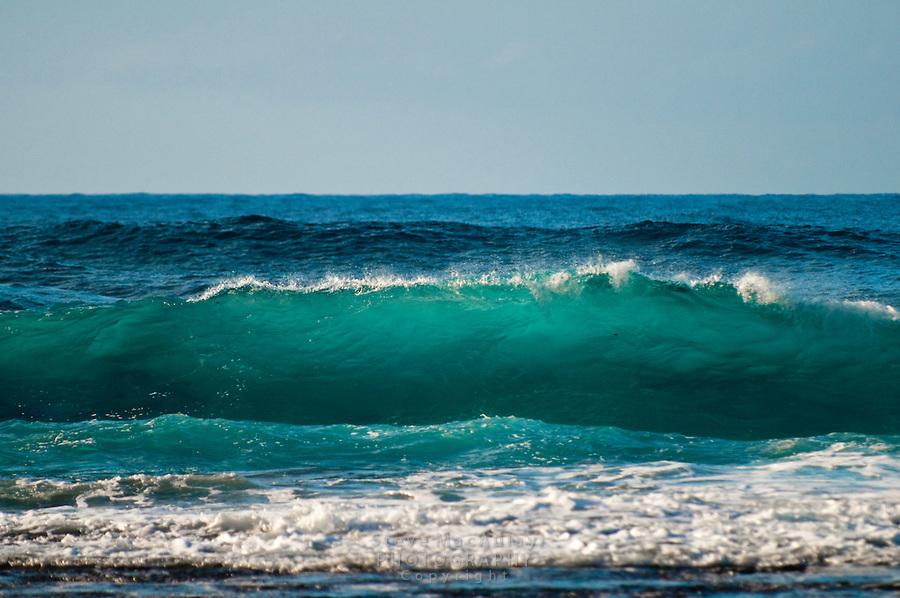 Colorful waves crashing ashore at Ke'e Beach, Northshore, Kauai, Hawaii