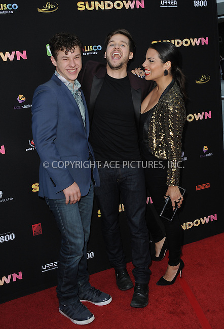 WWW.ACEPIXS.COM<br /> <br /> May 11 2016, LA<br /> <br /> Nolan Gould and Devon Werheiser (C) arriving at the premiere of 'Sundown' at the ArcLight Hollywood on May 11, 2016 in Hollywood, California<br /> <br /> By Line: Peter West/ACE Pictures<br /> <br /> <br /> ACE Pictures, Inc.<br /> tel: 646 769 0430<br /> Email: info@acepixs.com<br /> www.acepixs.com