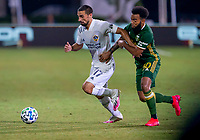 13th July 2020, Orlando, Florida, USA;  Los Angeles Galaxy midfielder Sebastian Lletget (17) and Portland Timbers midfielder Eryk Williamson (30) during the MLS Is Back Tournament between the LA Galaxy versus Portland Timbers on July 13, 2020 at the ESPN Wide World of Sports, Orlando FL.