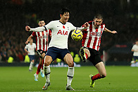 9th November 2019; Tottenham Hotspur Stadium, London, England; English Premier League Football, Tottenham Hotspur versus Sheffield United; Chris Basham of Sheffield United tackles Son Heung-Min of Tottenham Hotspur - Strictly Editorial Use Only. No use with unauthorized audio, video, data, fixture lists, club/league logos or 'live' services. Online in-match use limited to 120 images, no video emulation. No use in betting, games or single club/league/player publications