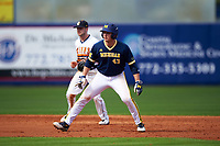 Michigan Wolverines first baseman Carmen Benedetti (43) leads off second in front of shortstop Anthony Massicci during the second game of a doubleheader against the Canisius College Golden Griffins on February 20, 2016 at Tradition Field in St. Lucie, Florida.  Michigan defeated Canisius 3-0.  (Mike Janes/Four Seam Images)