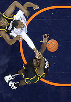 CHARLOTTESVILLE, VA- DECEMBER 6: Bryon Allen #0 of the George Mason Patriots grabs a rebound in front of Akil Mitchell #25 of the Virginia Cavaliers during the game on December 6, 2011 at the John Paul Jones Arena in Charlottesville, Virginia. Virginia defeated George Mason 68-48. (Photo by Andrew Shurtleff/Getty Images) *** Local Caption *** Bryon Allen;Akil Mitchell
