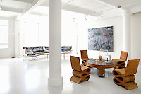 wooden dining set<br /> <br /> The loft of Ena Swansea was designed by architect David Shermann as a living and working space on West 17th Street in the Flatiron District of New York City.