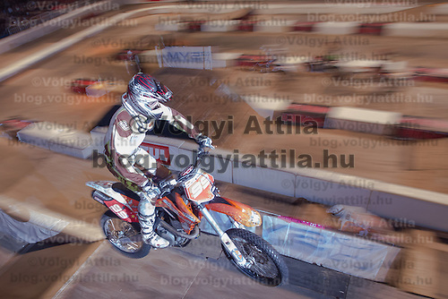 Zsolt Szekeres from Hungary competes during the Indoor Super Moto-Cross race in Budapest, Hungary on February 4, 2012. ATTILA VOLGYI