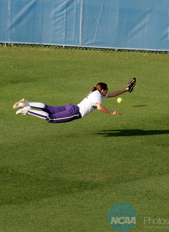 02 JUNE 2009:  Aly McWherter (22) of the University of Washington dives for a fly ball in center field during the Division I Women's Softball Championship held at the ASA Hall of Fame Stadium in Oklahoma City, OK.  Washington defeated Florida 3-2 in game two to win the national championship.  Shane Bevel/NCAA Photos
