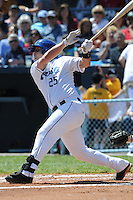 Asheville Tourists Bryce Massanari #25 swings at a pitch during a game against  the Lexington Legends at McCormick Field in Asheville,  North Carolina;  April 17, 2011. Lexington defeated Aheville 18-9.  Photo By Tony Farlow/Four Seam Images