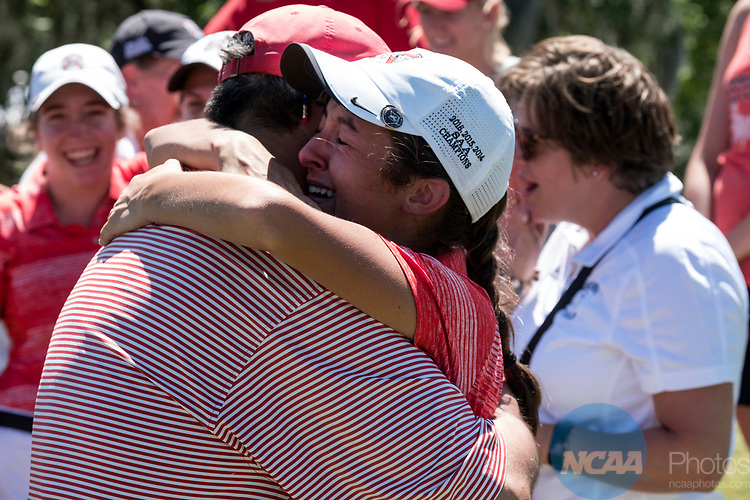 HOUSTON, TX - MAY 12: Sarahanne Vaughan of Rhodes College hugs her father, as the team celebrates their victory during the Division III Women's Golf Championship held at Bay Oaks Country Club on May 12, 2017 in Houston, Texas. (Photo by Rudy Gonzalez/NCAA Photos/NCAA Photos via Getty Images)