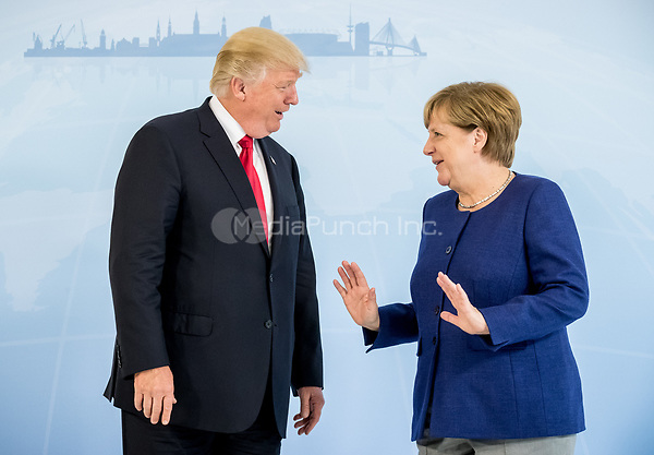 dpatop - German Chancellor Angela Merkel greets US President Donald Trump ahead of the G20 Summit in the Hotel Atlantic in Hamburg, Germany, 06 July 2017. The G20 Summit of the heads of government and state takes place on 7 and 8 July 2017 in Hamburg. Photo: Michael Kappeler/POOL dpa/dpa /MediaPunch ***FOR USA ONLY***