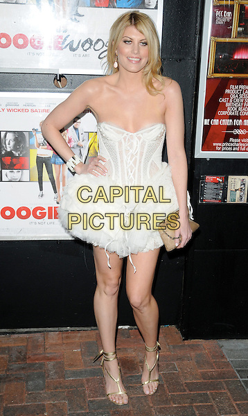 MEREDITH OSTROM .attending the gala screening of 'Boogie Woogie' at the Prince Charles Cinema, Leicester Square, London, England, UK, .April 13, 2010..full length white strapless corset lace-up dress hand on hip ruffles ruffle tulle gold strappy sandals open toe shoes beige clutch bag cuff bracelet .CAP/CAN.©Can Nguyen/Capital Pictures.