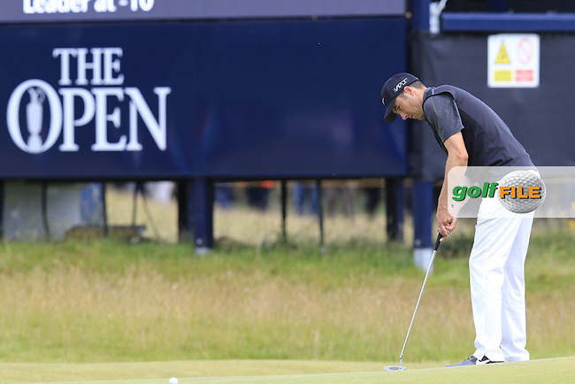 Ross FISHER (ENG) putts on the 15th green during Sunday's Round  of the 144th Open Championship, St Andrews Old Course, St Andrews, Fife, Scotland. 19/07/2015.<br /> Picture Eoin Clarke, www.golffile.ie