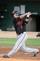 Bakersfield Blaze third baseman Alex Buchholz #9 bats against the Lancaster JetHawks at Clear Channel Stadium on July 4, 2011 in Lancaster,California. (Larry Goren/Four Seam Images)