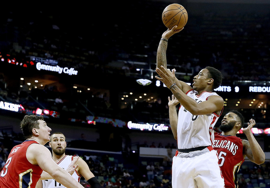NEW ORLEANS, LA - MARCH 26: DeMar DeRozan #10 of the Toronto Raptors shoots over Omer Asik #3 of the New Orleans Pelicans during the second half of a game at the Smoothie King Center on March 26, 2016 in New Orleans, Louisiana. The Raptors won 115-91. NOTE TO USER: User expressly acknowledges and agrees that, by downloading and or using this photograph, User is consenting to the terms and conditions of the Getty Images License Agreement.  (Photo by Jonathan Bachman/Getty Images)