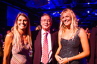 Darling Harbour, Sydney. (20th February, 2013): Pam Burridge (AUS), Deputy Prime Minister Wayne Swan (AUS) and Stephanie Gilmore (AUS). Australian surfing celebrated its champions tonight with Mark Richards and Stephanie Gilmore honoured at the Australian Surfing Awards in Sydney...The Awards marked a significant milestone in Surfing Australia's history as it celebrated its 50th Anniversary following its formation in 1963 as the Australian Surfriders Association and over 500 guests celebrated at the gala event. It was an unprecedented gathering of Australian surfing legends from the past 50 years...Four-times World Champion Mark Richards was named Australia's Most Influential Surfer 1963-2013, while five-times World Champion Stephanie Gilmore was inducted as the 35th member of the Australian Surfing Hall of Fame...The campaign to find Australia's 10 Most Influential Surfers 1963-2013 was conducted through a public vote and through votes provided by the members of the Australian Surfing Hall of Fame...The 10, in order of votes received, was: Mark Richards, Simon Anderson, Nat Young, Michael Peterson, Midget Farrelly, Tom Carroll, Layne Beachley, Wayne Bartholomew, Mark Occhilupo and Bob McTavish...Peter 'Joli' Wilson's photo of the wave Cloudbreak off Fiji during the enormous run of swell in June won the Nikon Surf Photo of the Year and Storm Surfers 3D featuring Ross Clarke-Jones and Tom Carroll was named the Nikon Surf Movie of the Year...2013 AUSTRALIAN SURFING AWARDS WINNERS..Australian Surfing Hall of Fame Inductee: Stephanie Gilmore.Australia's Most Influential Surfer 1963-2013: Mark Richards.Male Surfer of the Year: Joel Parkinson.Female Surfer of the Year: Stephanie Gilmore.Rising Star: Jack Freestone.Waterman of the Year: Jamie Mitchell.ASB Surfing Spirit Award: Misfit Aid.Peter Troy Lifestyle Award: Bob Smith.Surf Culture Award: The Reef - by the Australian Chamber Orchestra and Tura New Music.Simon Anderson Club Award: Kirra Surfriders Club.Nikon Surf Movi
