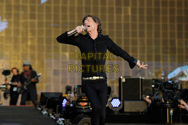 Mick Jagger of The Rolling Stones <br /> performing at Barclaycard British Summertime, Hyde Park, London, England, UK, <br /> 13th July 2013.<br /> music concert gig festival live on stage half length black shirt microphone arms singing <br /> CAP/MAR <br /> &copy; Martin Harris/Capital Pictures