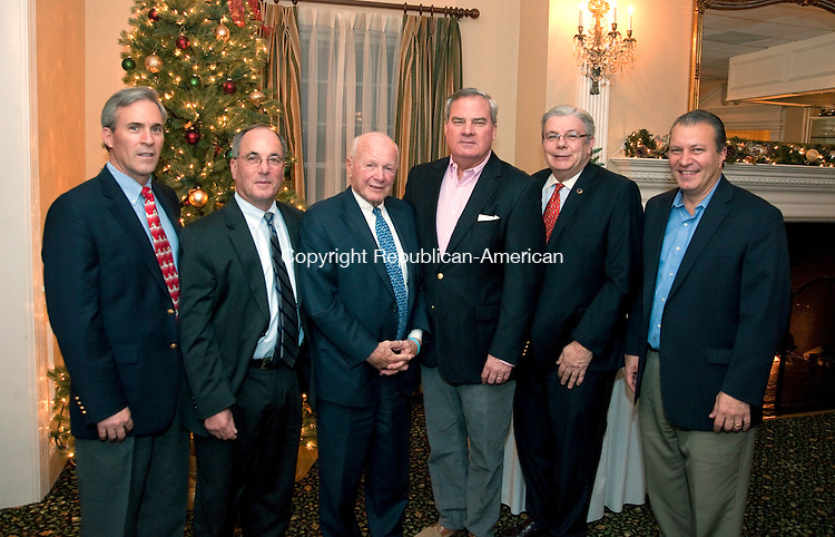 WATERBURY, CT 120413JS05- Santa Toy Fund committee member  Bill Palomba of Watertown; Mike Martone of Cheshire; Sen. Joseph J. Crisco Jr., D-Woodbridge; former Governor John G. Rowland; board member JohnW. Betkoski, III and Paul Curey of West Hartford,  at the Waterbury Youth Service's annual Santa's Toy Fund gathering at the Country Club of Waterbury. <br /> Jim Shannon Republican-American