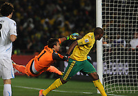 In one of South Africa's best scoring chances, forward Katlego Mphela pushes a header just past the hands of goalkeeper Fernando Muslera, but wide of the goal.Uruguay defeated South Africa, 2-0, in both teams' second match of play in Group A of the 2010 FIFA World Cup. The match was played at Loftus Versfeld in Pretoria, South Africa June 16th.