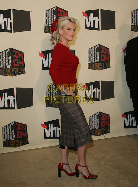 JENNY McCARTHY.The VH1 Big in 04  Award Show held at The Shrine Auditorium in Los Angeles, California .December 1, 2004.full length, red cardigan, hands on hips, tweed skirt, red shoes.www.capitalpictures.com.sales@capitalpictures.com.Supplied by Capital Pictures