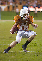 04 November 2006: Texas quarterback Colt McCoy (#12) runs with the ball during the Longhorns 36-10 victory over the Oklahoma State University Cowboys at Darrel K Royal Memorial Stadium in Austin, Texas.