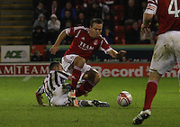 Dougie Imrie fouls Gavin Rae to be booked in the Aberdeen v St Mirren Scottish Communities League Cup match played at Pittodrie Stadium, Aberdeen on 30.10.12..