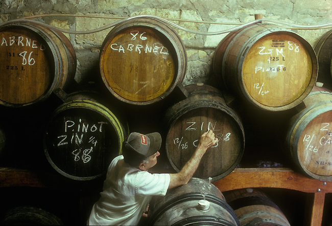 Home winemaker, Angelo Regusci, labels barrels in his barn near Napa