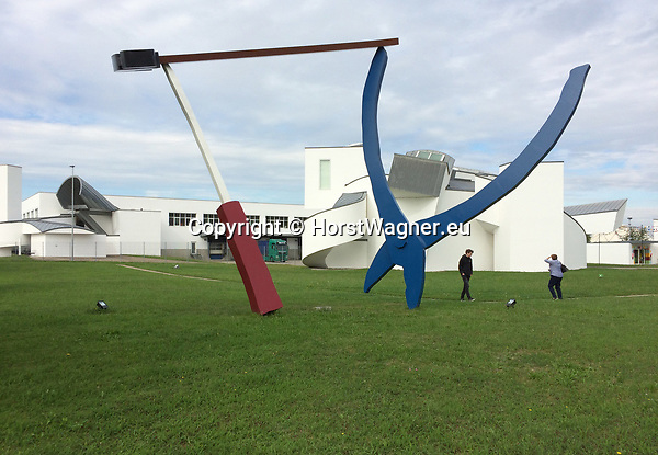 Germany, Weil am Rhein -- September 04, 2017 -- Vitra Campus, a production site (mainly furniture) and field of experimentation for architecture and design; here, the Vitra Design Museum, by Frank Gehry, with ' Balancing Tools ', by Claes Oldenburg & Coosje van Bruggen  -- © HorstWagner.eu