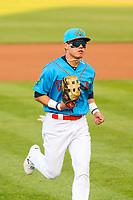 Wisconsin Timber Rattlers outfielder Jesus Lujano (7) jogs to the dugout between innings during a Midwest League game against the Lake County Captains on May 10, 2019 at Fox Cities Stadium in Appleton, Wisconsin. Wisconsin defeated Lake County 5-4. (Brad Krause/Four Seam Images)