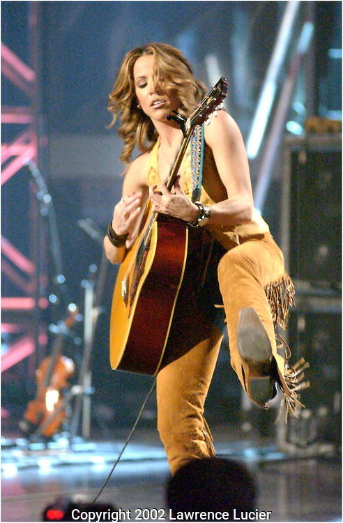 Recording artist Sheryl Crow performs at the celebration of the 10th anniversary of the National Breast Cancer Coalition March 6, 2002, in New York.  The concert was taped for rebroadcast on April 6th, 2002. (Photo by Lawrence Lucier)