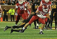 NWA Media/Michael Woods --11/28/2014-- w @NWAMICHAELW...University of Arkansas tight end Hunter Henry is brought down by a Missouri defender in the 4th quarter of Friday afternoons game against Missouri at Faurot Field in Columbia Missouri.