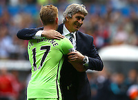 Manchester City manager Manuel Pellegrini hugs Kevin De Bruyne at full time during the Barclays Premier League match between Swansea City and Manchester City played at The Liberty Stadium, Swansea on 15th May 2016