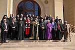 Egyptian representatives of Christian denominations pose following a meeting in Cairo on February 18, 2013. Representatives of several different Christian denominations present in Egypt met this morning in St Mark's Coptic Orthodox cathedral in the capital's al-Abbasiya district, to sign the statutes of the country's first National Council of Christian Churches. Photo by Tarek al-Gabas