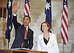 U.S. President Barack Obama waves after signing the visitors book with Australian Prime Minister Julia Gillard at Parliament House, Canberra, Australia, on Wednesday, November 16th, 2011. Photographer: Mark Graham/Bloomberg